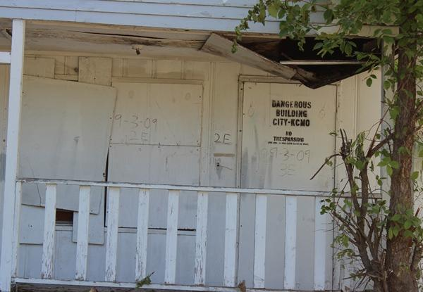 Other houses, like this one, along this stretch of Brooklyn are boarded up and labelled as a dangerous building.