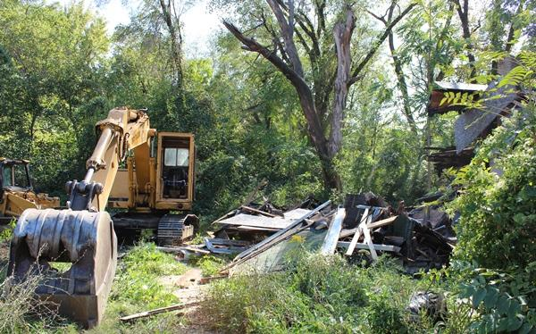 The demolished house is ready for the bulldozer.