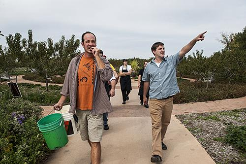 Matt Bunch, horticulturist at the Heartland Harvest Garden, guides Chef Ted Habiger, co-owner of Room 39, and his staff on a tour of the gardens.
