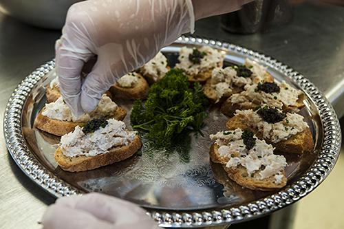 Through his many contacts with local farmers, Ted Habiger's menu included farm-raised L'Osage Paddlefish caviar.