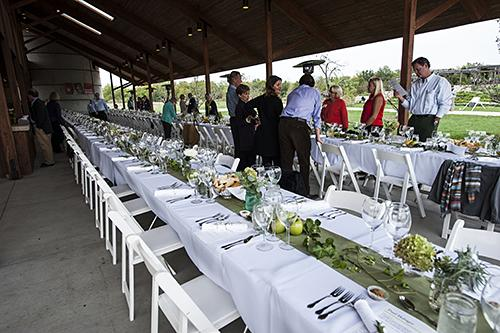 Guests begin to arrive for dinner on the terrace of the Missouri barn.