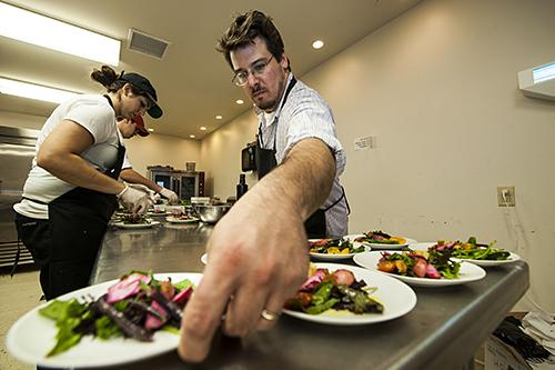 Sous chef Paul Hasty puts the final touches on a salad.