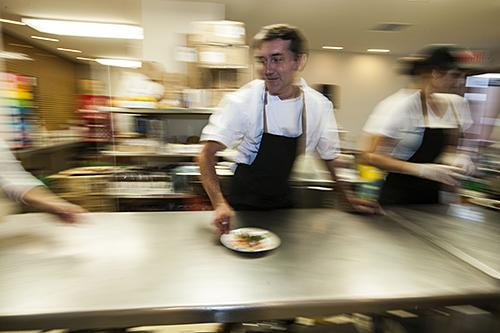 Chef Ted Habiger rushes a salad plate to servers.