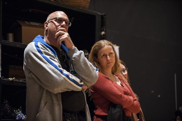 Dressers Kyle Mowry and Marianne Rowse watch the action on stage from the wings.