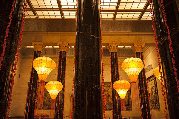 Glowing lanterns float between the marbled columns of Kirkwood Hall.