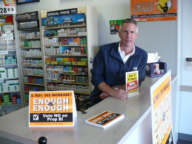 Steve Barbour, owner of Cigarettes 4 Less in KCMO, worries about how a tax increase would affect his business, located 80 feet from the Kansas border. Cigarettes are cheaper here than in Kansas right now, but that would change if a tax were approved.