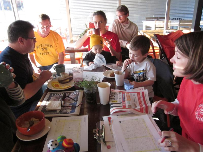 Parents and their children gather at a coffee house in Waldo to discuss education.