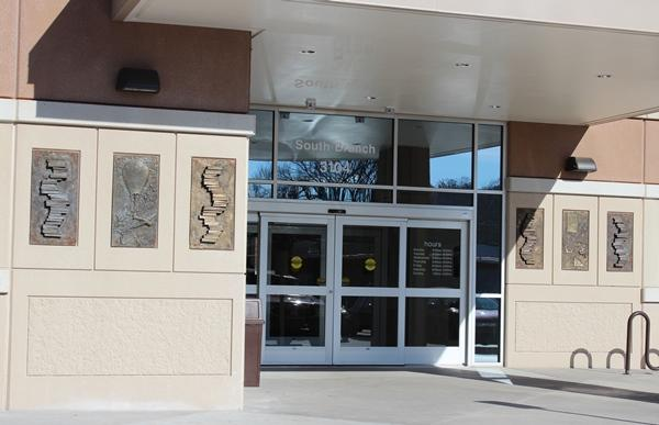 Michael Wickerson's nine-panel bronze installation is near the front entrance at the South Branch Library in Kansas City, Kan.