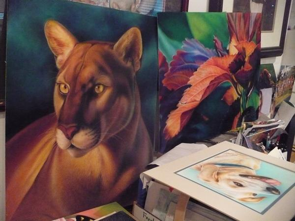 Paintings inside Lee's Overland Park studio of wildlife.  She has written many instructional drawing books.