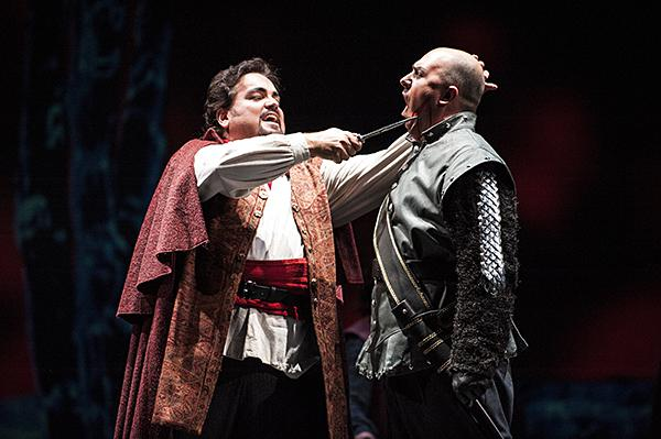 Rafael Davila, as Manrico, prevents Roman Burdenko, as Count di Luna, from kidnapping Leonora.