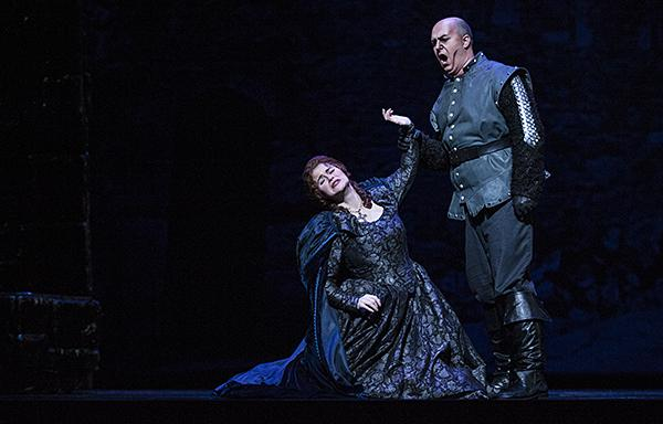 After Manrico is captured while trying to rescue Azucena, Michele Capalbo, as Leonora, pleads with Roman Burdenko, as Count di Luna. When the Count does not relent, she offers herself to him.