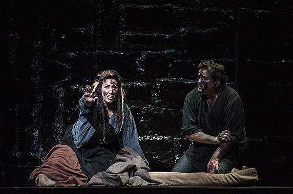 Imprisoned, Nancy Maultsby, as Azucena, and Rafael Davila, as Manrico, remember happier times.