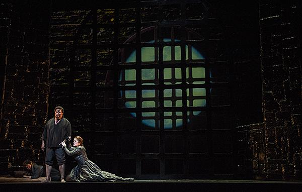 Michele Capalbo, as Leonora, begs Rafael Davila, as Manrico, to flee the prison.