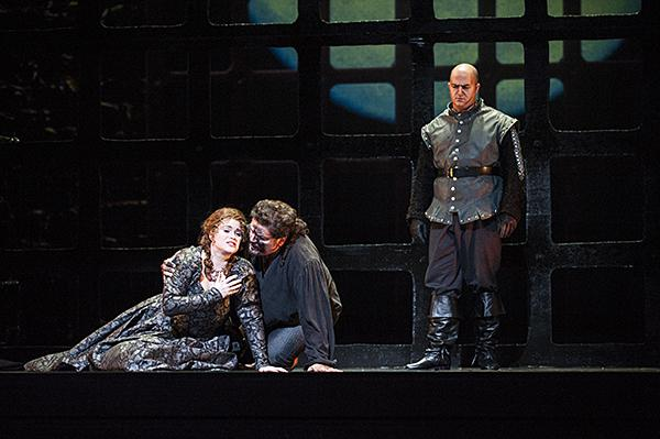 Michele Capalbo, as Leonora, confesses to Rafael Davila, as Manrico, that she has secured his freedom by promising herself to the Count.  But she has poisoned herself to remain true to him.