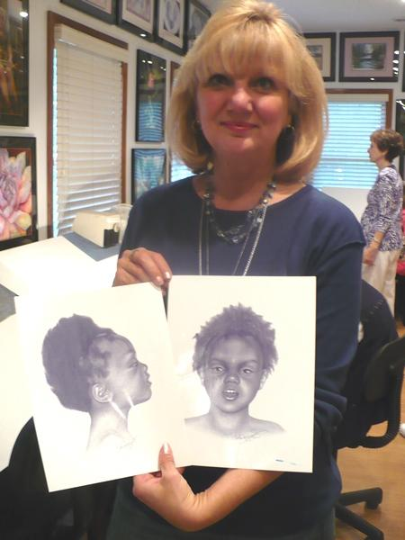 Lee Hammond shows her renderings of victim Precious Doe.