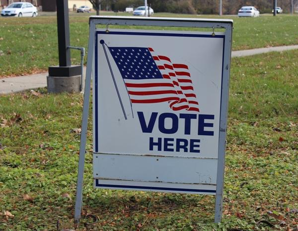 "A ""vote here"" sign in Kansas City, Mo."