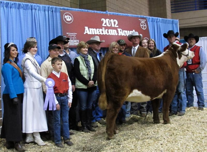 Owner Rhett Lowderman and his team gather around his prize-winning Hereford, LCC Patton Kiwi 116 ET, which won the Reserve Grand and Champion Intermediate Female Award at the American Royal.