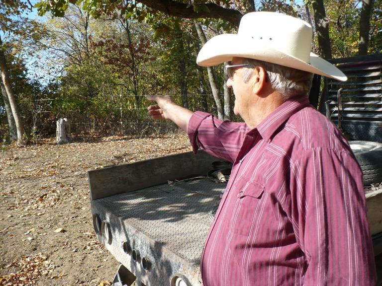 Larry Smithers points to the fence he put up in '09, the area where he believes he got sick.