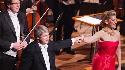 Kansas City Symphony Music Director Michael Stern and mezzo-soprano Joyce DiDonato. Concertmaster Noah Geller, pictured at far left.