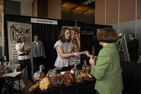 Lindsay Borum, of the Farm to Market Bread Company, hands out samples and business cards.