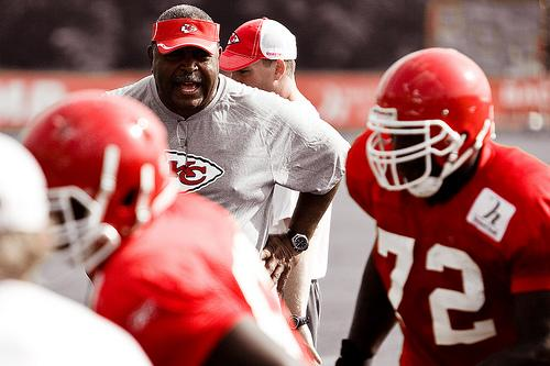 omeo Crennel coaches Glenn Dorsey during footwork drills.