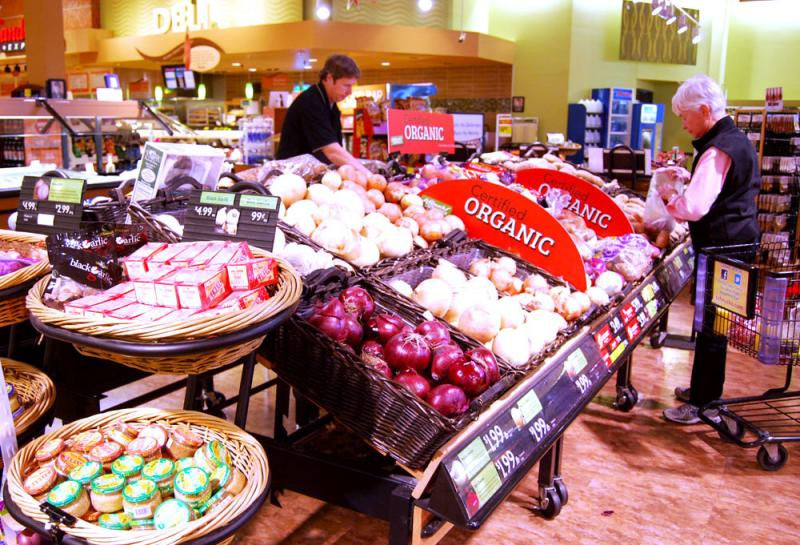 Schnuck's produce manager Dave Guthrie unpacks potatoes in the grocery's Columbia, Mo., store produce department.