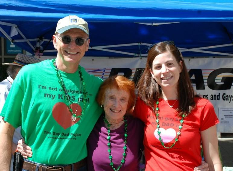 Larry Best, Amity Buxton, and Erin (Best) Margolin smile for a photo together at Oakland Pride.