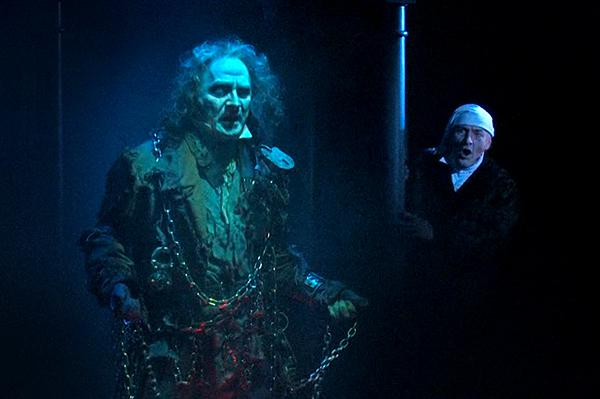 Mark Robbins, as Ghost of Jacob Marley, and Gary Neal Johnson, as Ebenezer Scrooge.