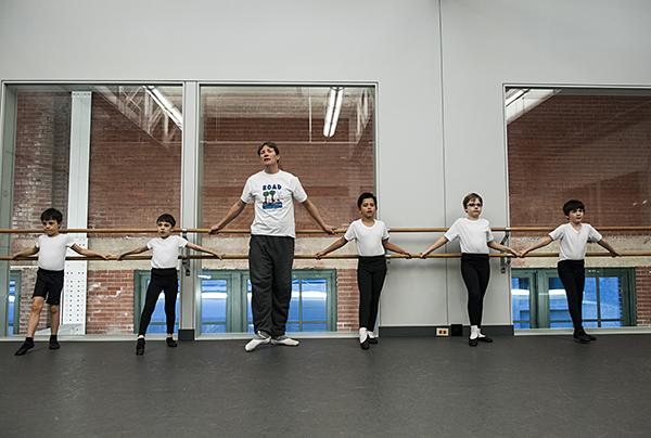 Ballet Instructor Sean Duss lines up his students as the Monday class for boys begins.