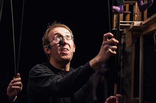 Puppeteer Mike Horner operates and voices multiple puppets from his spot beneath the stage.