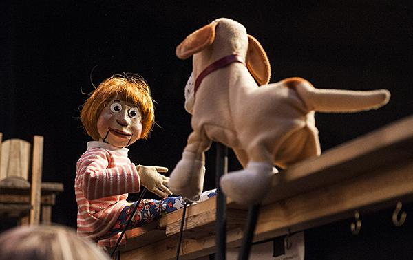 Helen and Martha play onstage operated by the puppeteers below.