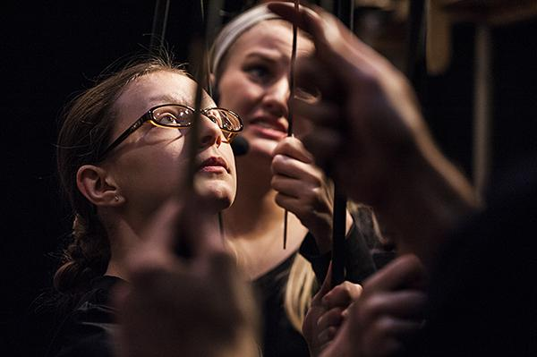 Apprentice puppeteer Finoula Emmons concentrates on the action onstage.