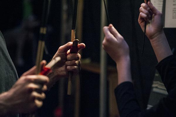 Puppeteers control the action using sticks.