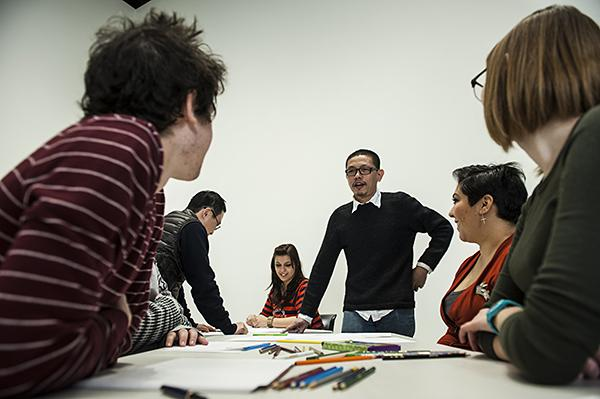 Xijing Men artist Chen Shaoxiong, of China, speaks with students as they work.
