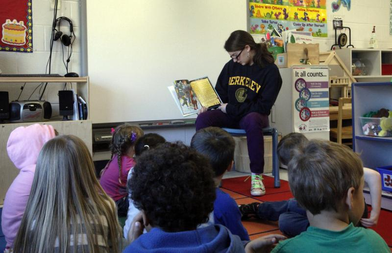 Lily Wade reads to a preschool class at the Child Development Center aboard Marine Corps Air Station in Cherry Point, N.C.