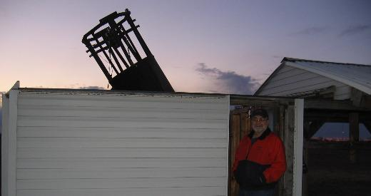 Gary Hug stands by his homemade telescope in Scranton, Kansas.
