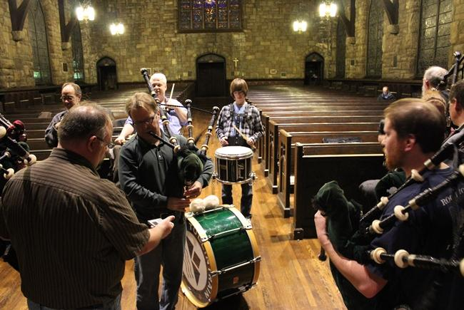 Bagpiper Steve Kidwell assists other pipers with tuning.