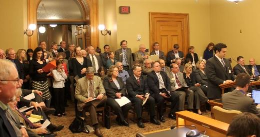 Opponents and supporters of the lobbying bill packed a committee room.