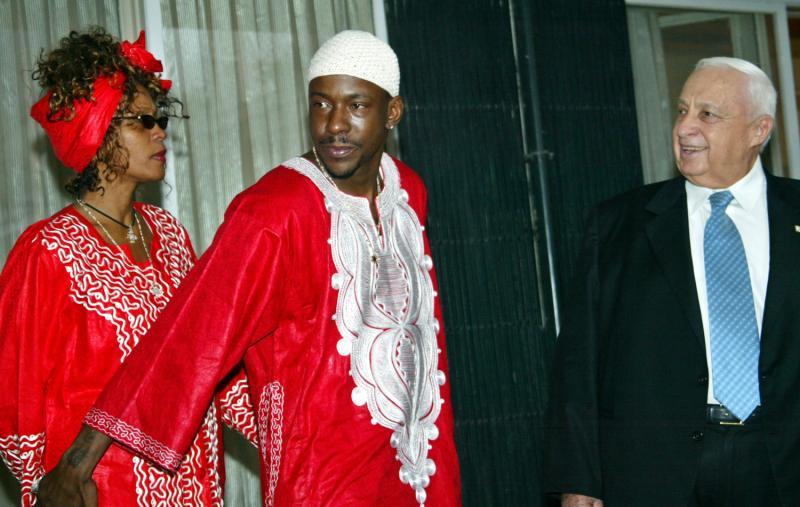 Whitney Houston and Bobby Brown meet Israeli Prime Minister Ariel Sharon. 2003