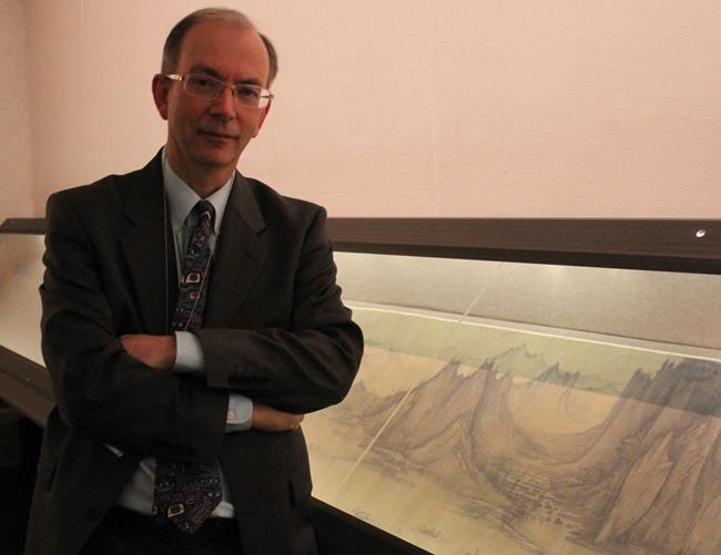 "Curator Colin Mackenzie in the ""holy of the holies,"" the Chinese painting gallery."