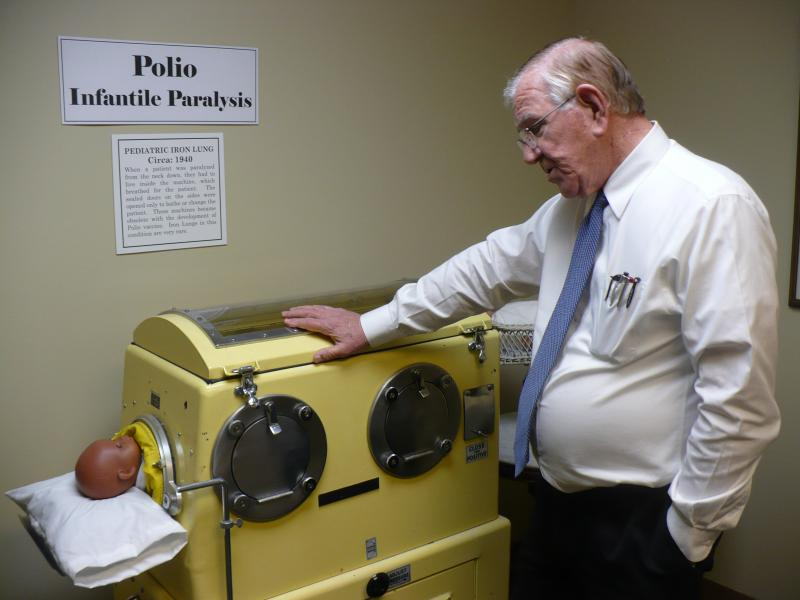 Dr. Bruce Hodges has a pediatric iron lung on display at his new medical museum. The old respirators were used to help paralyzed polio patients breathe.