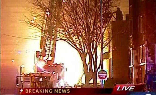 TV-9 cameras capture a Kansas City fire truck silhouetted by the intense flames that destroyed a building near the Country Club Plaza