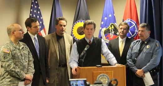 rownback and other state officials during a weather update in Topeka.