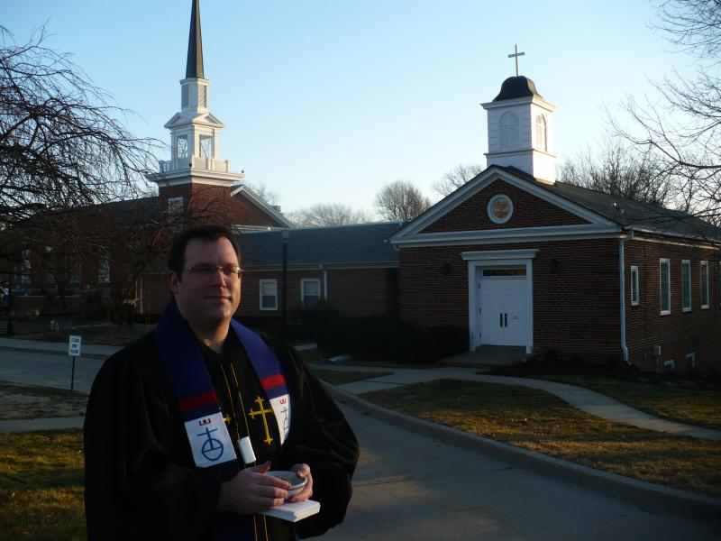 Pastor Aaron Roberts awaits commuters.