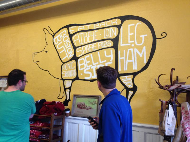 Visitors who walk in to The Local Pig, 2618 Guinotte Ave., in Kansas City are greeted by this mural, which explains exactly what they are about to buy.