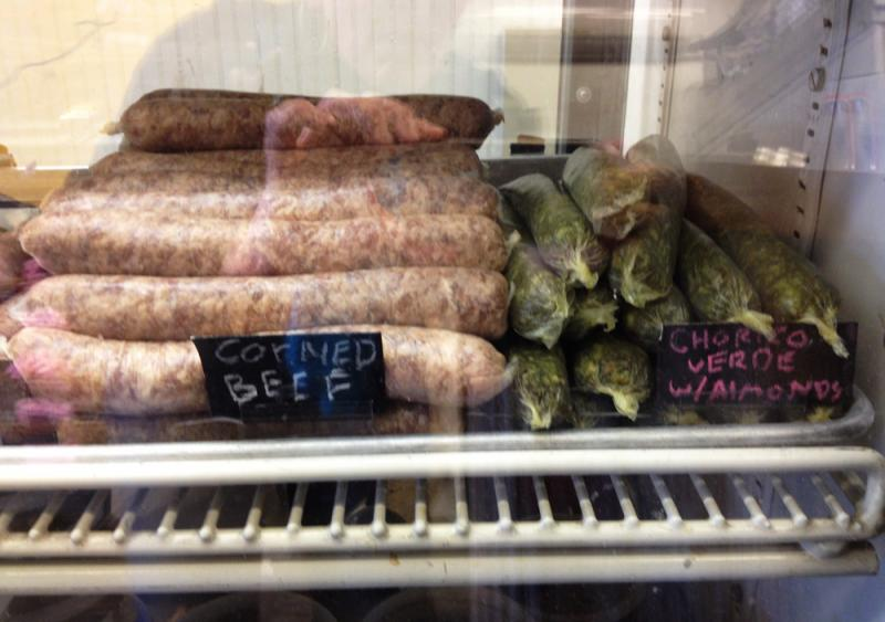 Some of the many kinds of sausages available at The Local Pig. The green ones to the right, chorizo verde, are so green because they are made with lots of cilantro.