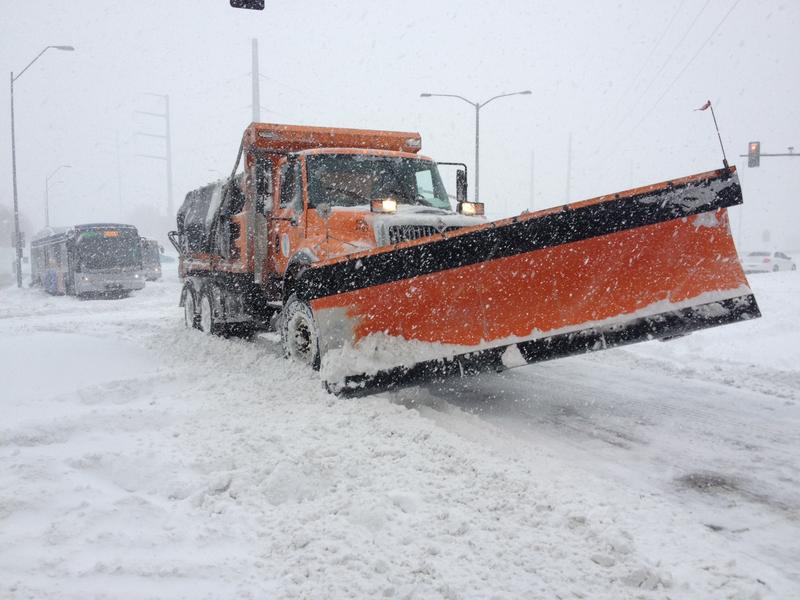 KC snowplows having a hard time getting through the stranded buses and cars.