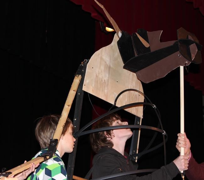 Students at Liberty Memorial Central Middle School demonstrate the movements of the minotaur puppet.