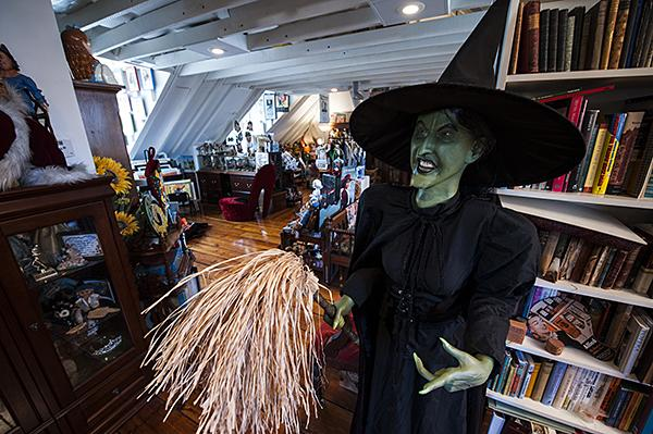 The Wicked Witch of the West with her broom watches over Albright's 'Wizard of Oz' collection.