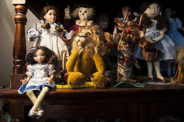 Dolls representing the characters from L. Frank Baum's books line the shelves of Albright's Oz room.